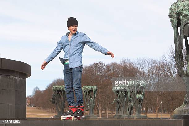 man riding his skateboard. - gustav vigeland sculpture park stock pictures, royalty-free photos & images