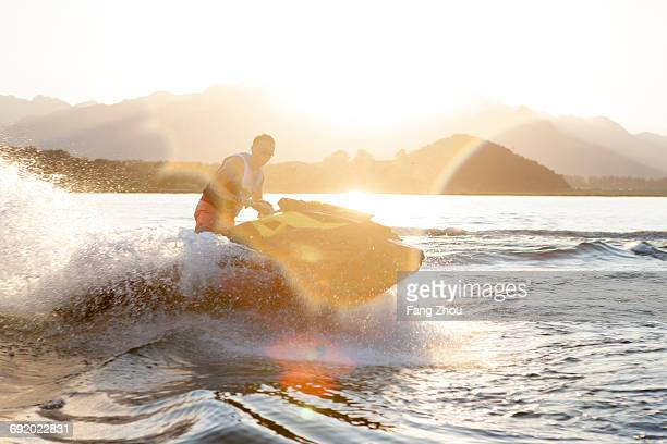 Man riding jet ski on lake, Beijing, China