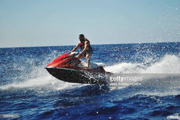 man riding jet ski - jet ski stock pictures, royalty-free photos & images