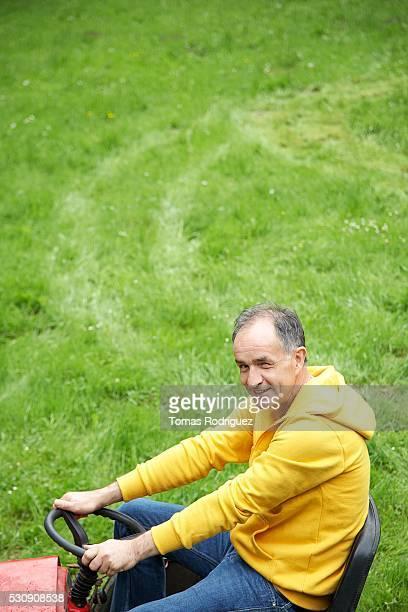 Man riding lawn mower