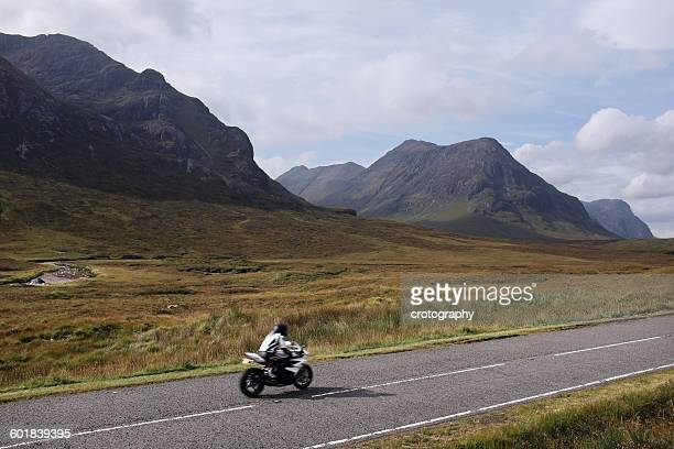 Man riding motorbike, Highlands, Scotland, USA