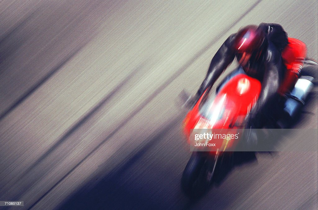 Man riding motorbike on street (blurred motion) : Stock Photo
