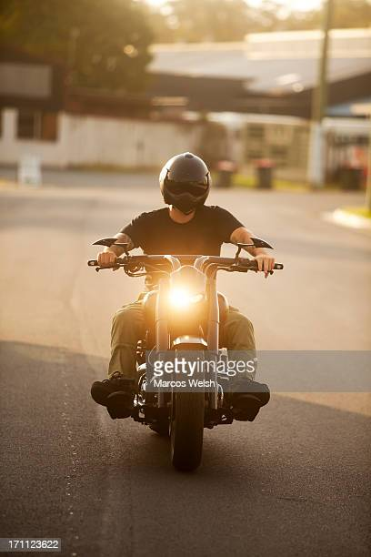Man Riding Motorbike with Helmet