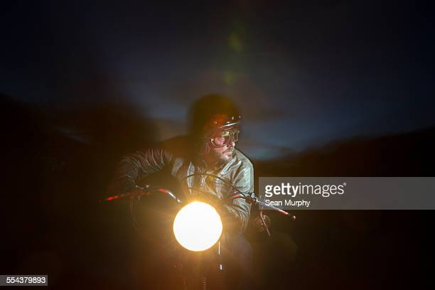 Man Riding Motorcycle at Night