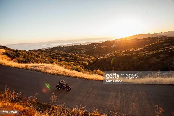 Man riding motorcycle on country roads, Santa Barbara County, California, USA