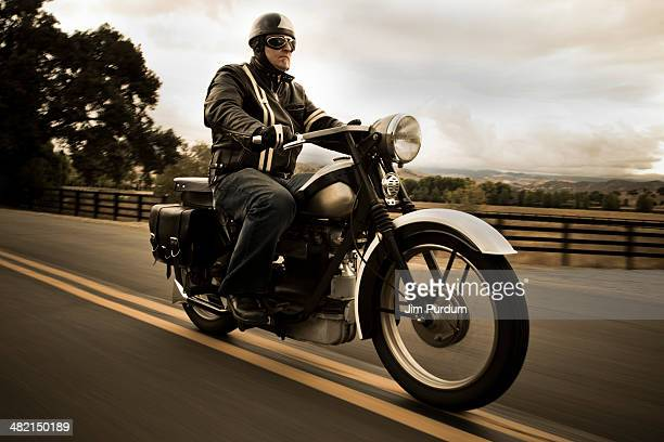 Man riding motorcycle on rural road