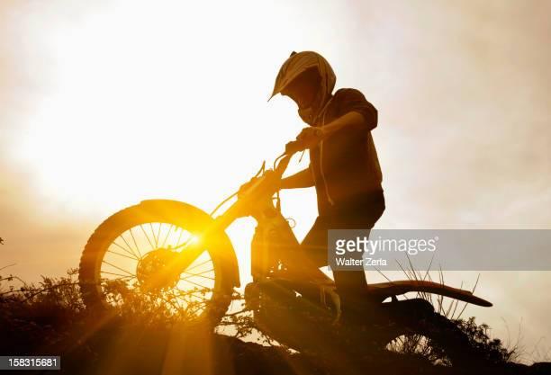 man riding motorcycle - motocross imagens e fotografias de stock