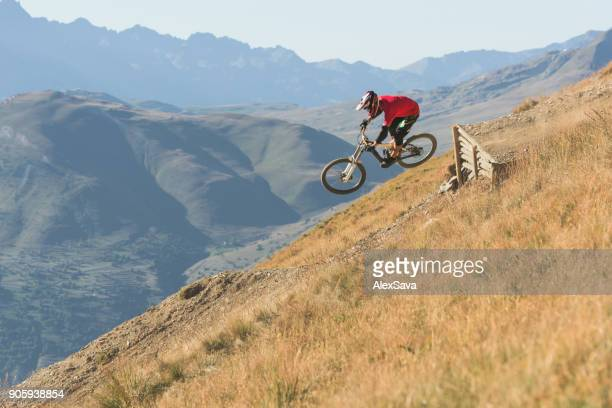 Man riding mountain bike downhill singletrack in Les Deux Alps