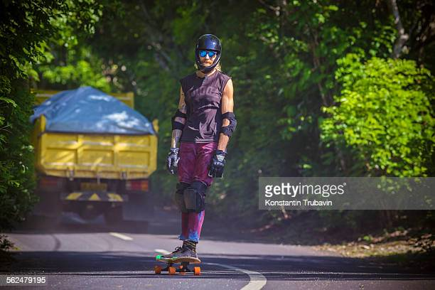man riding on a longboard skate, bali, indonesia. - padding stock pictures, royalty-free photos & images