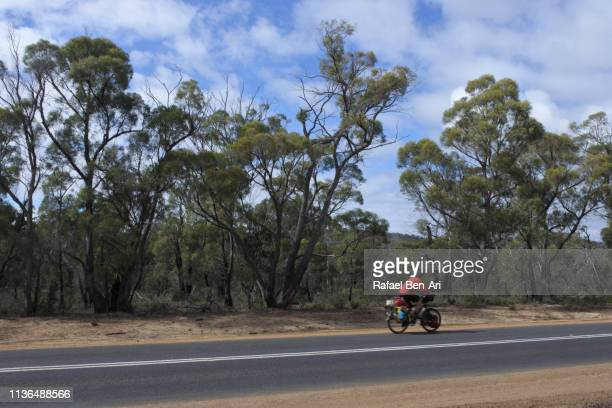 Man riding on bicycle in  Tasmania Australia