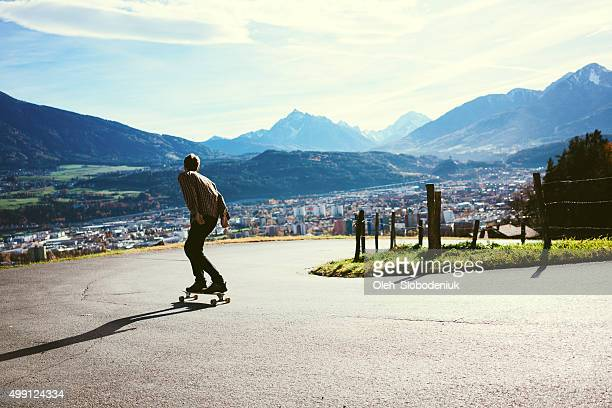 Man riding on longboard