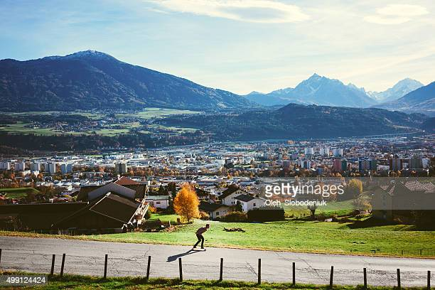 man riding on longboard - innsbruck stock pictures, royalty-free photos & images