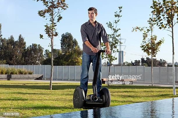 Man riding on segway.