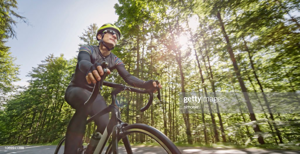 Man Riding Road Bike On Mountain Road Stock Photo - Getty Images