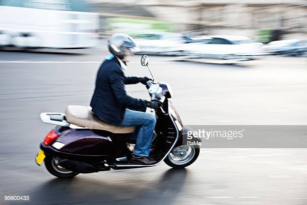 Man riding scooter, blurred motion
