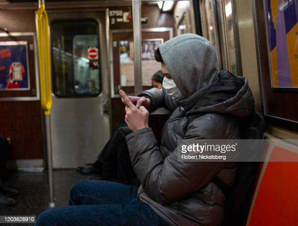A man riding the subway wears a medical facemark out of concern over the Coronavirus in the Brooklyn borough of New York City February 2 2020 The...