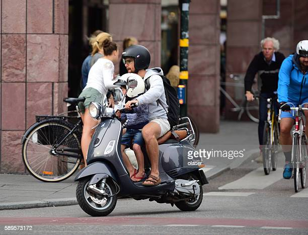 Man riding vespa/scooter in central stockholm