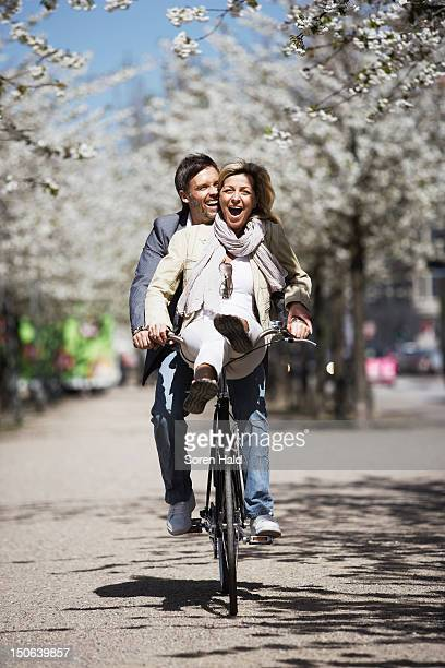 Man riding with girlfriend on bicycle