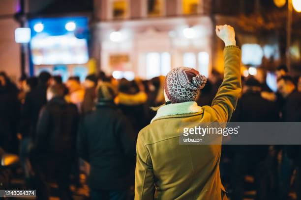 man rioting - marching stock pictures, royalty-free photos & images