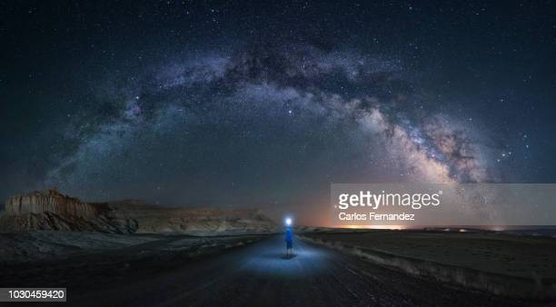 man, road and milky way - milky way stock pictures, royalty-free photos & images