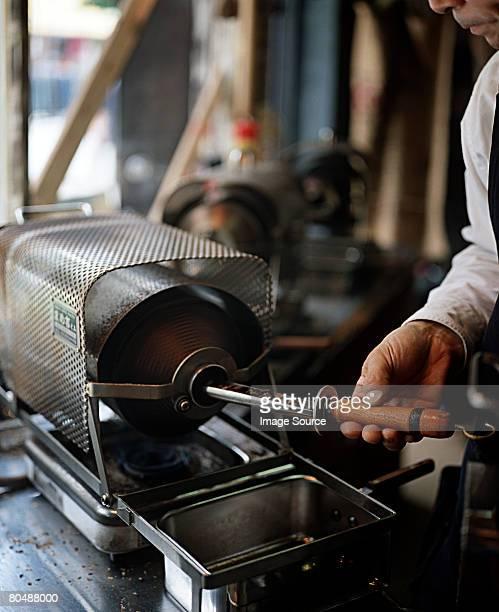 Man roasting coffee beans