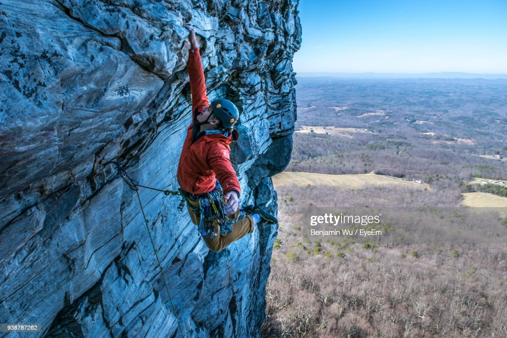 Man Rock Climbing Against Landscape High-Res Stock Photo ...