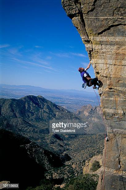 man rock climbing - mt lemmon stock photos and pictures