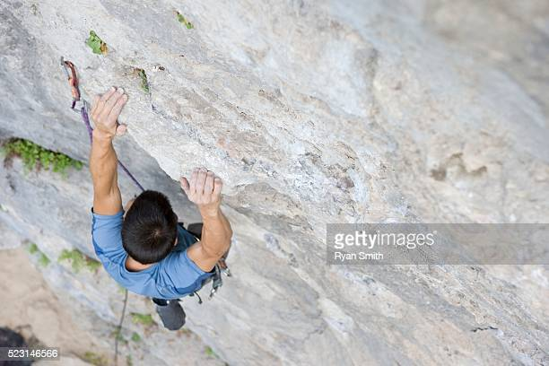 man rock climbing - chalk bag stock pictures, royalty-free photos & images