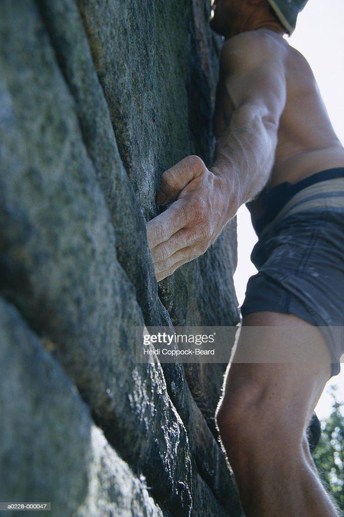Man Rock Climbing : Stock Photo