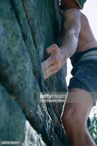 man rock climbing - heidi coppock beard stock-fotos und bilder