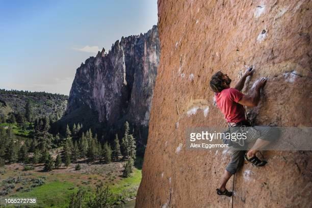 man rock climbing, smith rock state park, oregon, usa - scalare foto e immagini stock