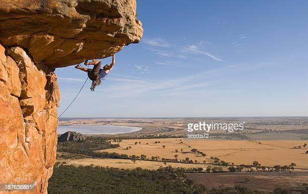 man rockclimbing - rock overhang stock photos and pictures