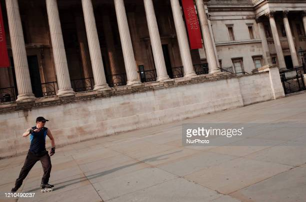 Man roller-skates in front of the closed National Gallery on the North Terrace of a near-deserted Trafalgar Square in London, England, on April 8,...