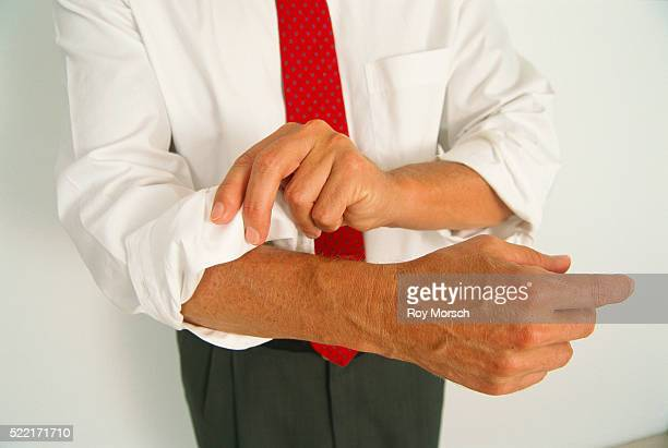 Man Rolling Up His Sleeves