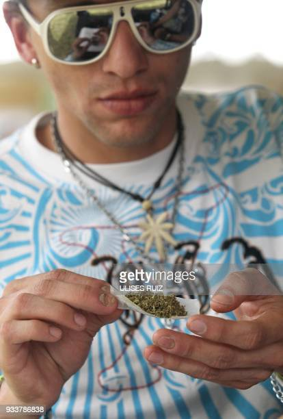 A man rolls a joint during the first Cannabis Cup where selfcultivation and the quality of the herb are encouraged in Tlajomulco de Zuniga Jalisco...