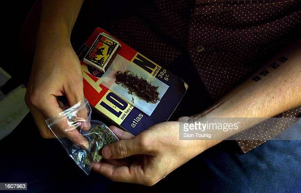 A man rolls a marijuana joint at his home August 8 2001 in the Dalston section of East London Cannabis use in the United Kingdom is still illegal but...