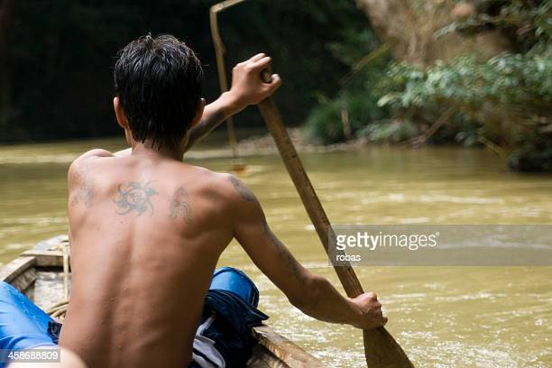 Man rowing a boat on Sarawak River