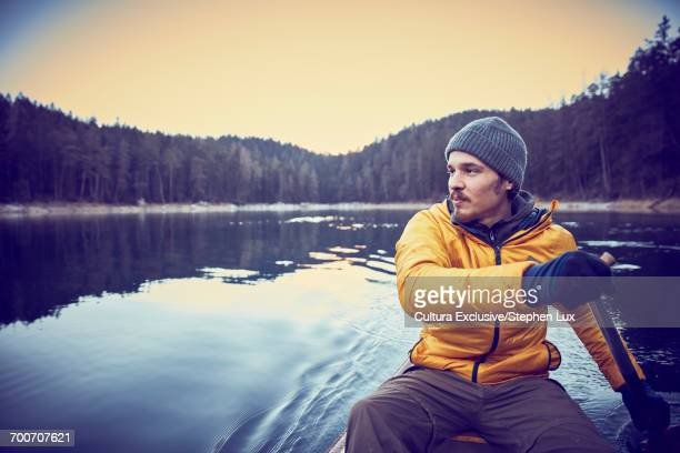 Man rowing, Eibsee Lake at base of Zugspitze, Garmisch-Partenkirchen, Bavaria, Germany