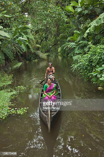 man rowing woman (53 years old) on wooden canoe along the scenic kerala backwaters, alappuzha, kerala, india - 55 59 years stock pictures, royalty-free photos & images