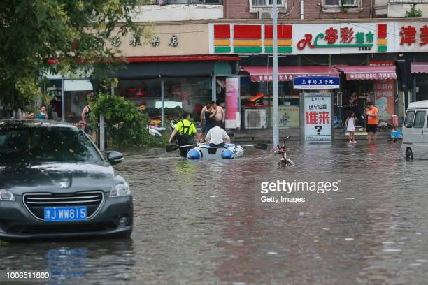 Man rows a rubber boat in a flooded road caused by rainstorm on July 24, 2018 in Tianjin, China. Heavy rain hit Tianjin on the evening of Monday.
