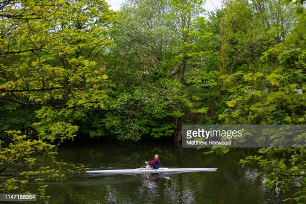 A man rows in a rowing boat on the River Taff on May 1 2019 in Cardiff United Kingdom
