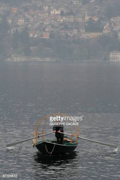 A man rows the 'Lucia ' the typical boat of Como Lake in Cernobbio 18 March 2006 US film stars Brad Pitt and Angelina Jolie are rumored to be...