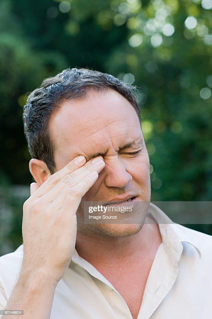 Man rubbing eye : Stock Photo