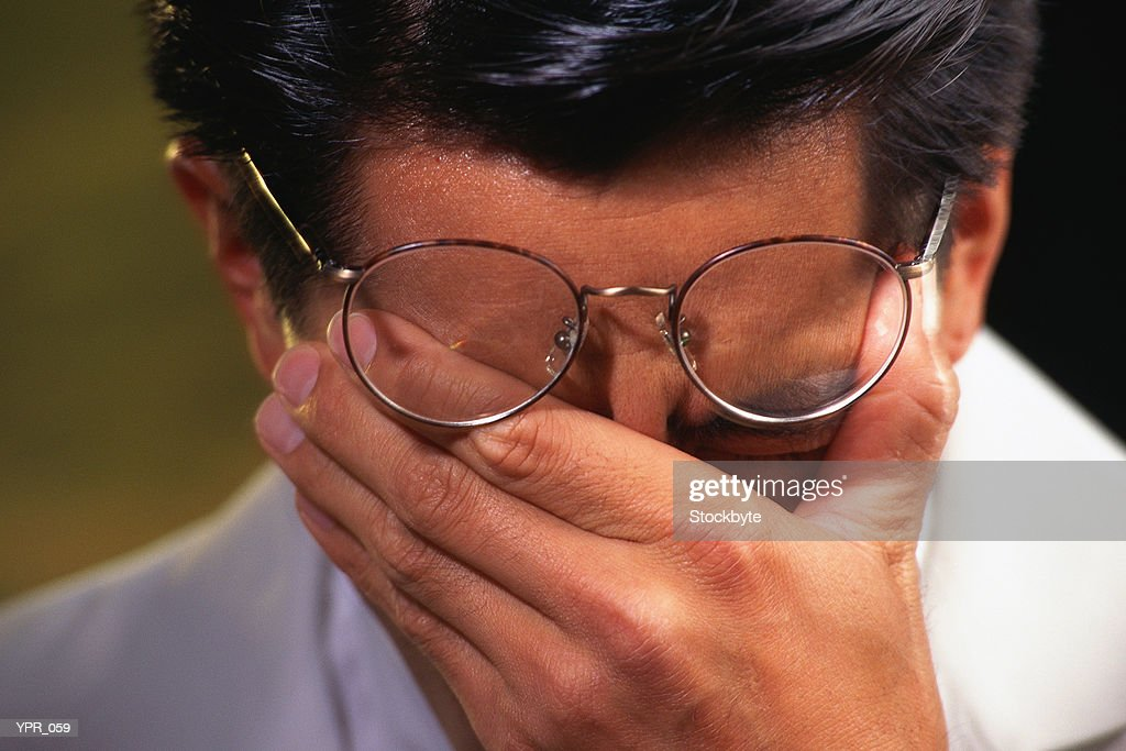 Man rubbing eyes : Stock Photo
