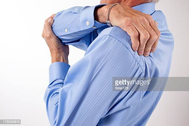 Mann Lotionen Schulter Schmerzen hast. Rückenschmerzen.