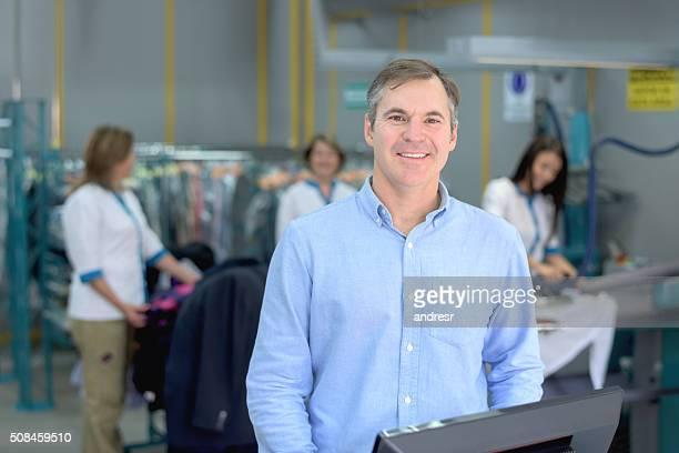 Man running a laundry service shop