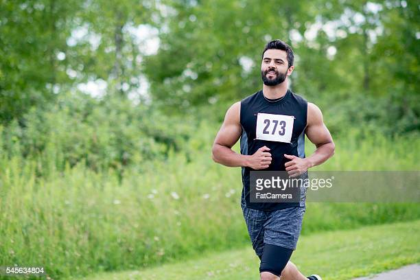 man running a marathon - 5000 meter stock pictures, royalty-free photos & images