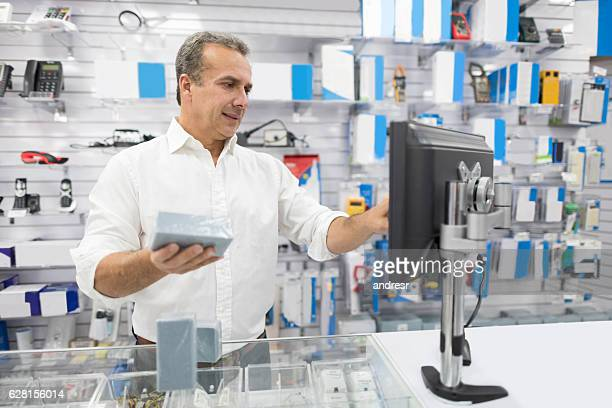 man running a tech store - electronics store stock photos and pictures