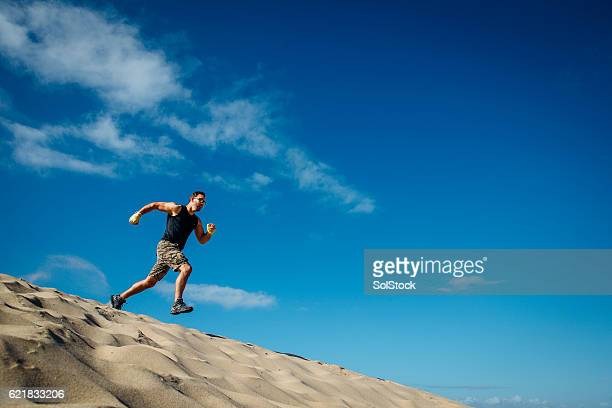 Man Running Alone Over Sand