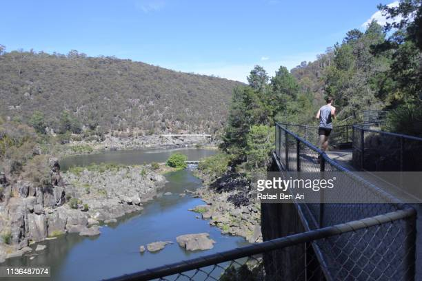 Man running along the Cataract Gorge  Tasmania Australia